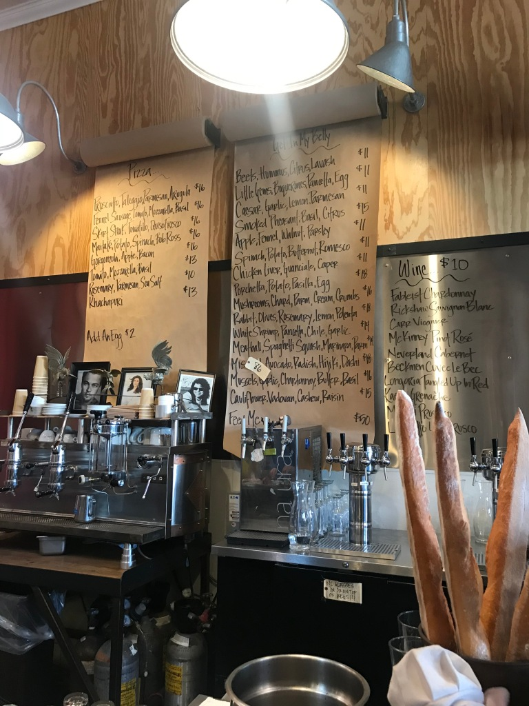 Interior picture of menu hanging on the wall at Industrial Eats.